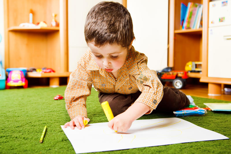 Boy drawing a picture royalty free stock photography