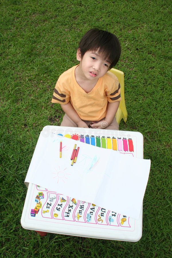 Boy at drawing table royalty free stock images