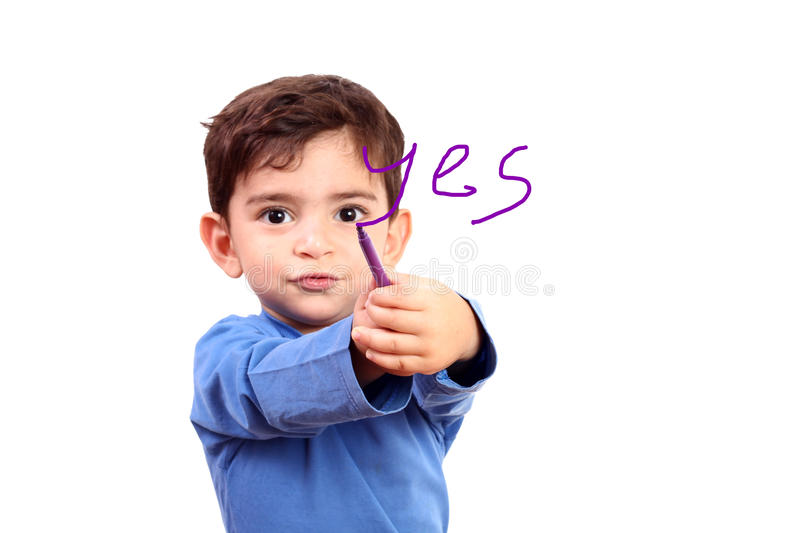 Boy drawing word yes stock photo