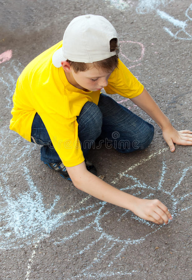 Download Boy draws on  asphalt stock image. Image of beautiful - 20750963