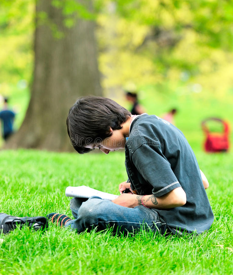 The boy draws in park royalty free stock photography