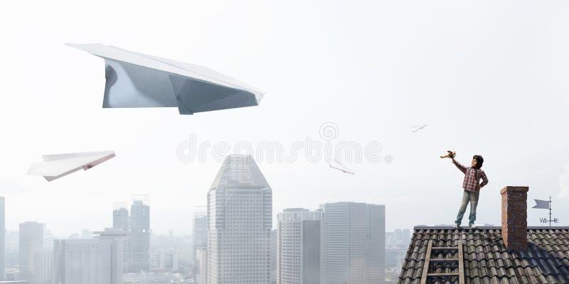 Boy dreaming of becoming pilot. Mixed media stock photo