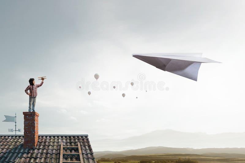 Boy dreaming of becoming pilot. Mixed media stock photos