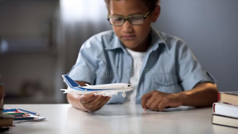 Boy dreaming of becoming pilot of modern airline and flying to faraway countries stock photos