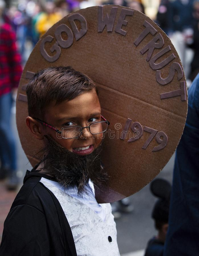 Warrenton, Virginia/USA-10/28/18: Boy dressed as a penny at the Halloween Happyfest Parade in Old Town Warrenton. Boy dressed as a penny at the Halloween stock photography