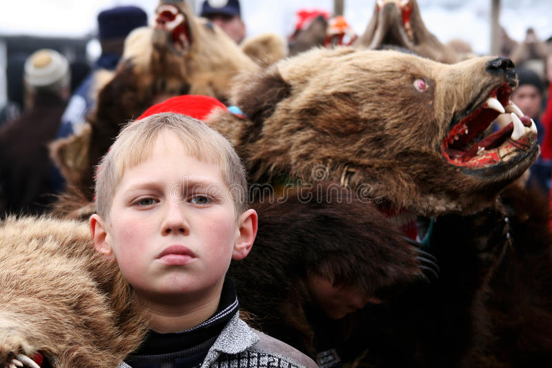 Boy dressed in bear skin stock photos