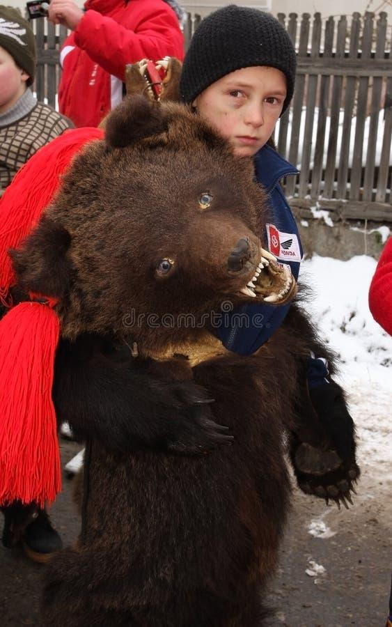 Boy dressed in bear skin royalty free stock photos