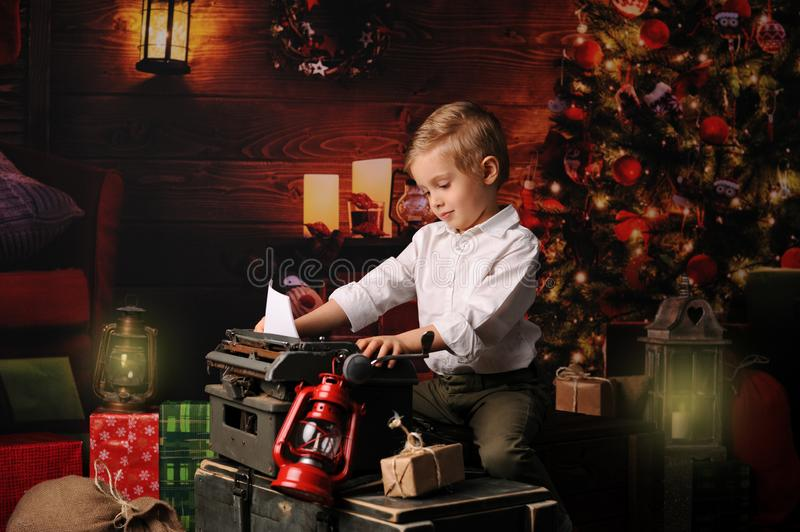 Boy dressed in Santa Claus`s Christmas royalty free stock images