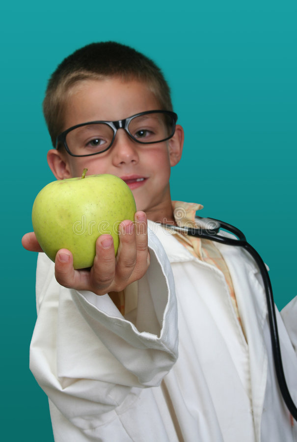 Boy dressed up as a doctor stock image