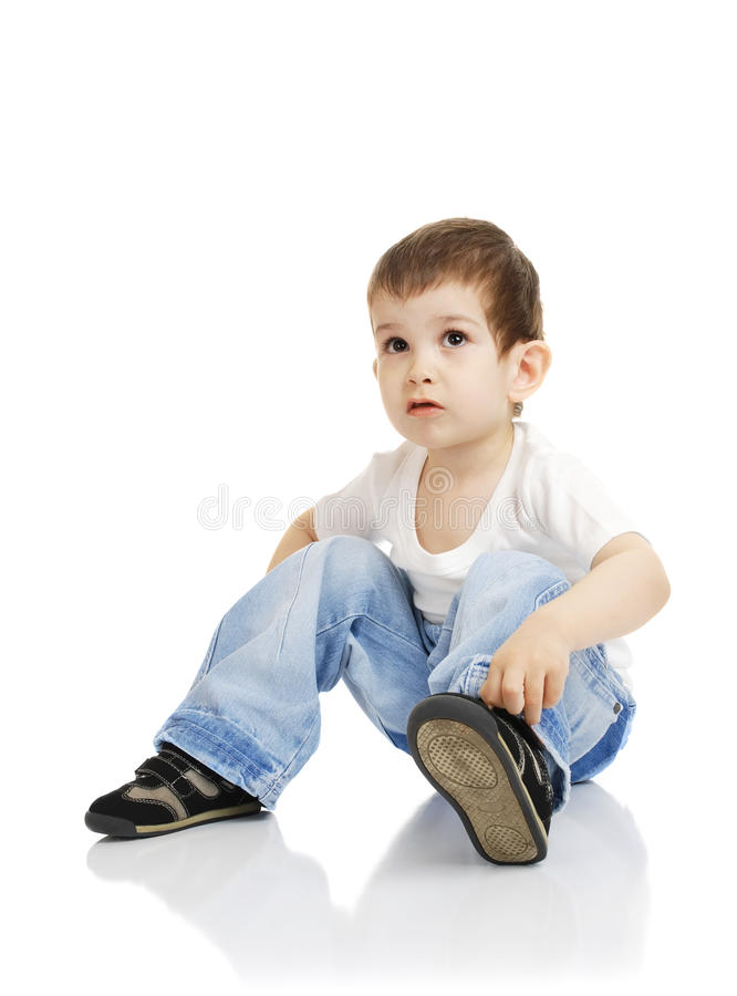 Download The boy dresses shoes stock image. Image of concentration - 9454167