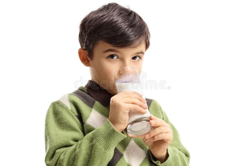 Boy drinking a glass of milk. Isolated on white background stock photos