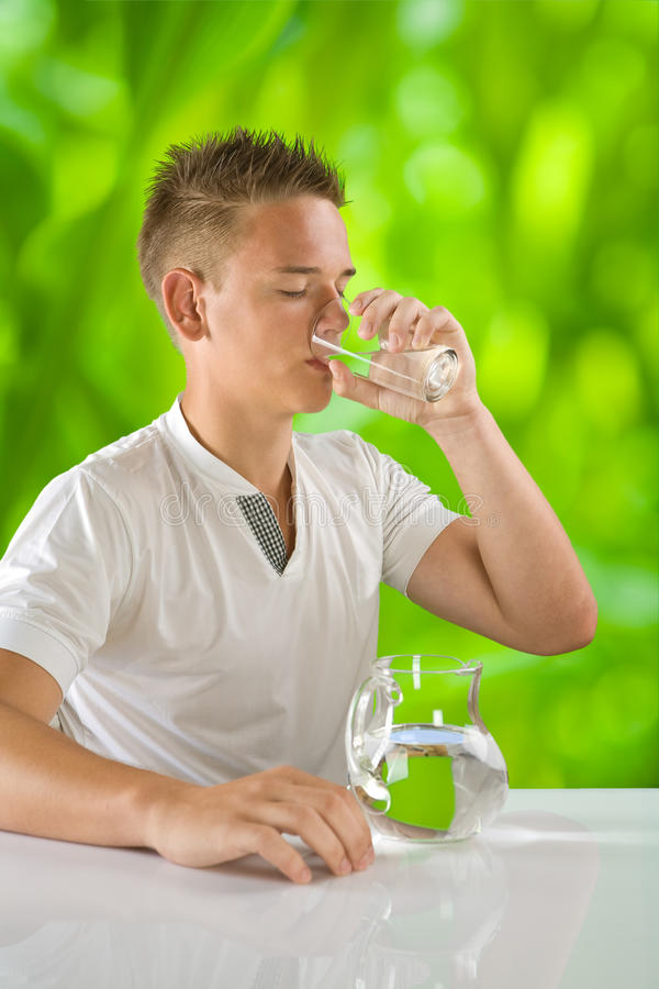 Download Boy drinking water stock image. Image of blue, close - 26154135