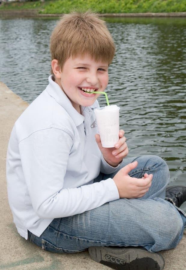 Download Boy drinks milkshake stock image. Image of people, kids - 2655203