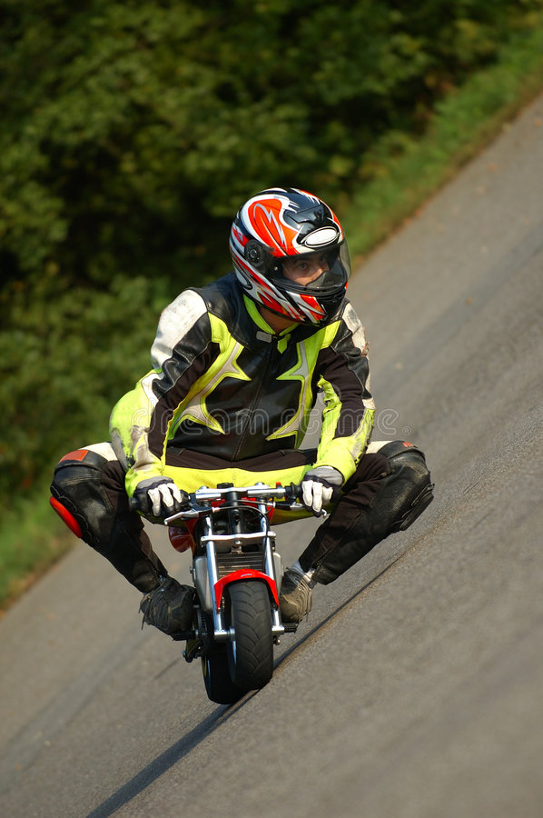 Boy Driving Minibike stock photos