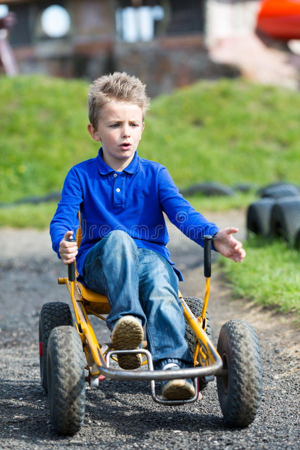 Boy driving moon buggy. Boy having fun with buggy cart. Trademarks have been removed royalty free stock images