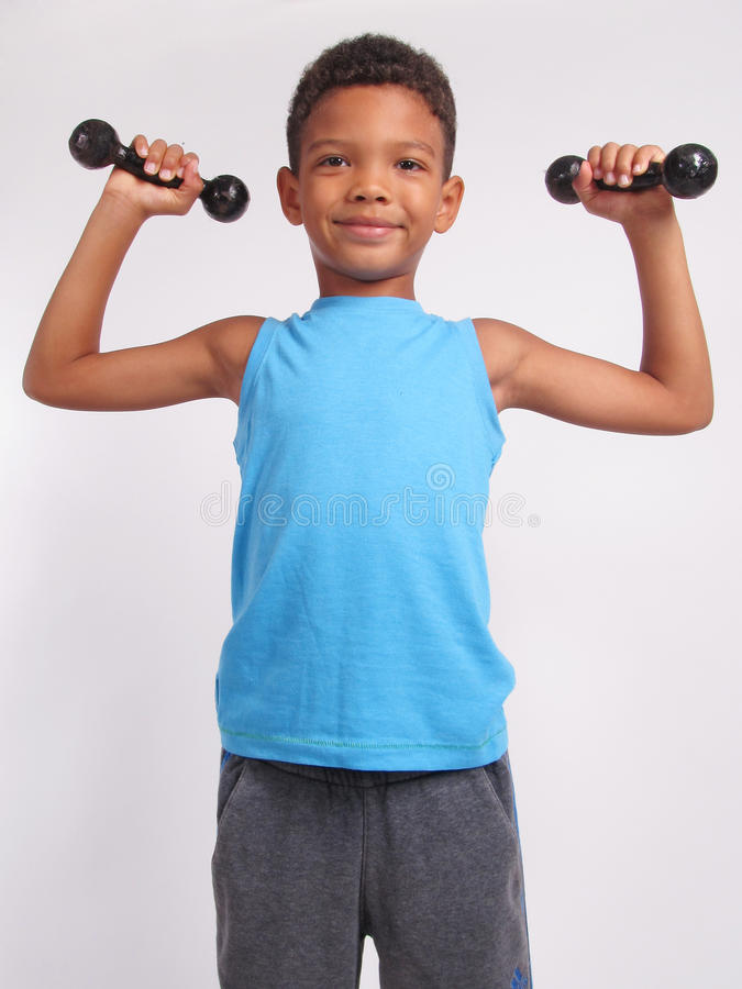 A boy with dumbbells. royalty free stock photos