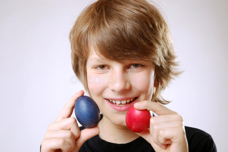 Boy with easter eggs. Smiling boy with two easter eggs stock photography