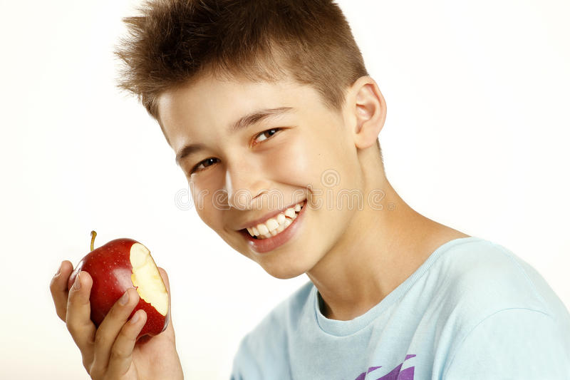 Download Boy eat apple stock photo. Image of caucasian, background - 25875766