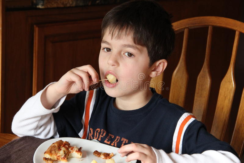 Boy eating apple. Boy eating cut apple for lunch stock image