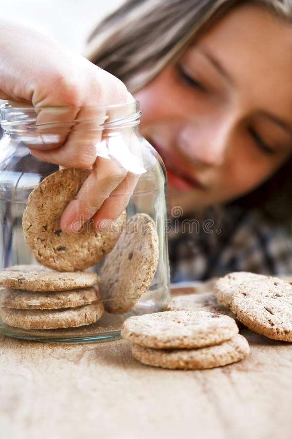 Boy eating a biscuit stock photos