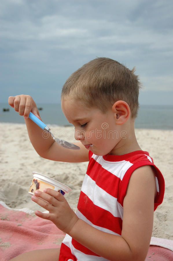 Boy is eating cheese stock photo. Image of water, child ...