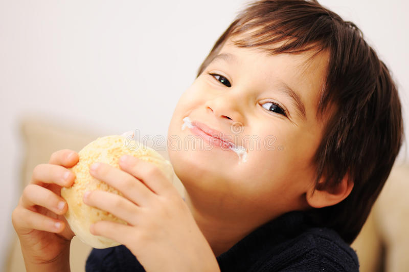 Boy eating healthy sandwich stock photography
