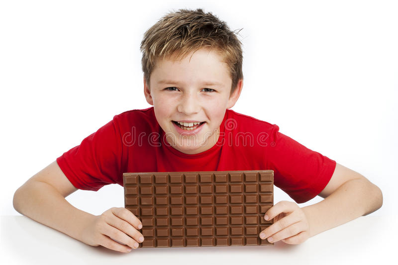 Boy Eating Huge Chocolate Bar royalty free stock photography