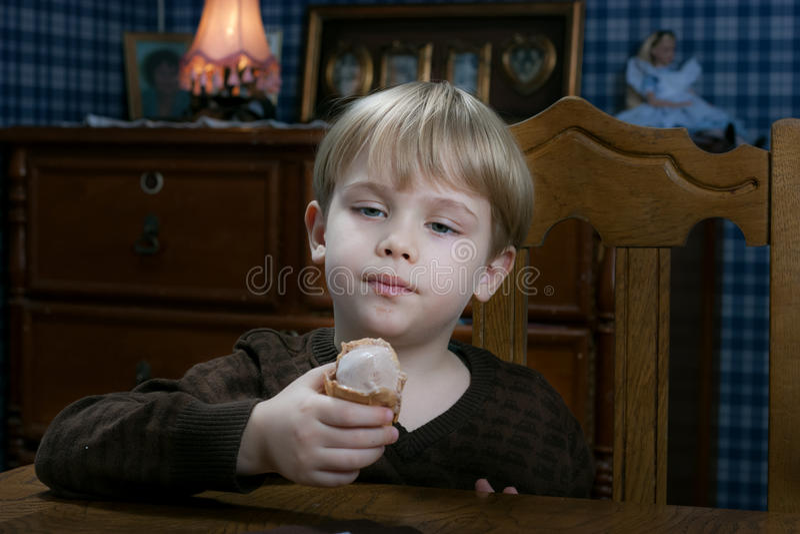 Boy eating ice cream stock image