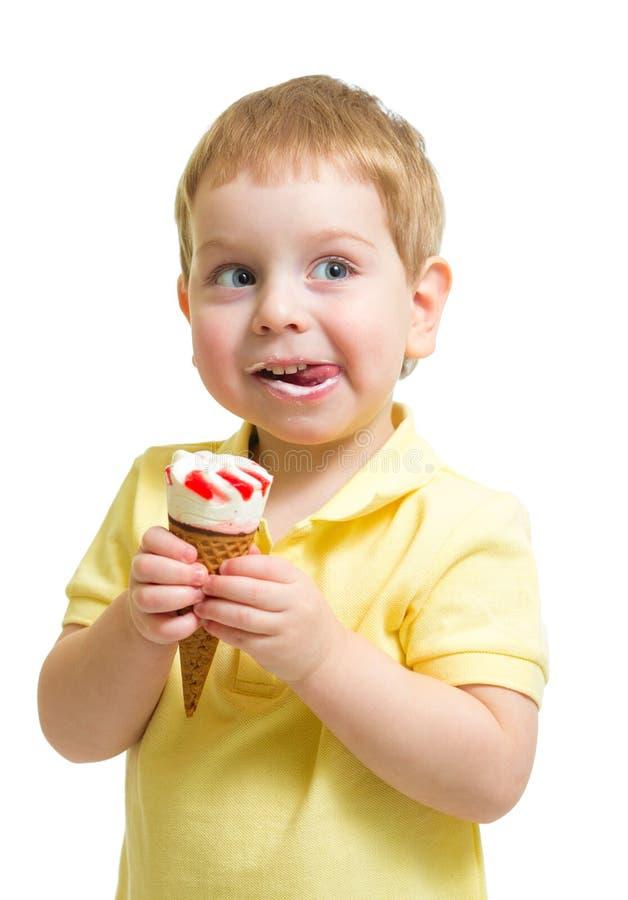 Kid eating ice cream or icecream isolated. Boy eating ice cream or icecream isolated on white stock photography