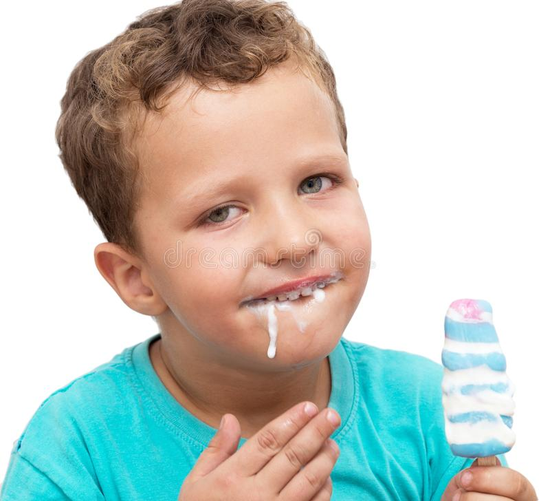 Boy eating ice cream on a white background royalty free stock photo