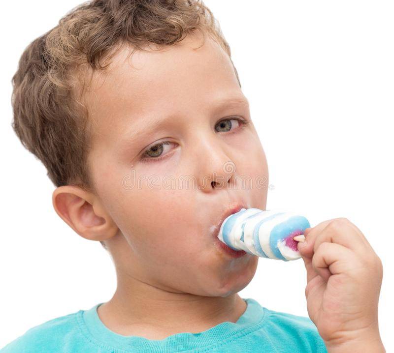 Boy eating ice cream on a white background royalty free stock image