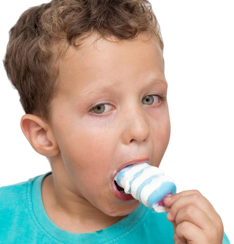 Boy eating ice cream on a white background royalty free stock images