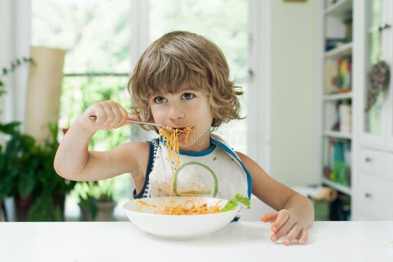 Boy eating pasta royalty free stock photo