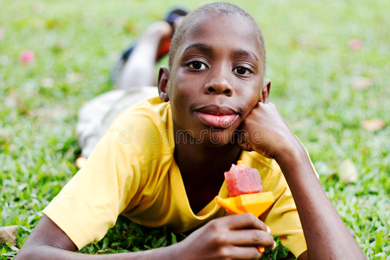 Boy eating popsicle royalty free stock photography