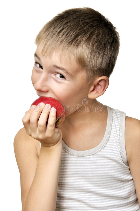 Download Boy eating red apple stock photo. Image of shirt, mouth - 20758176
