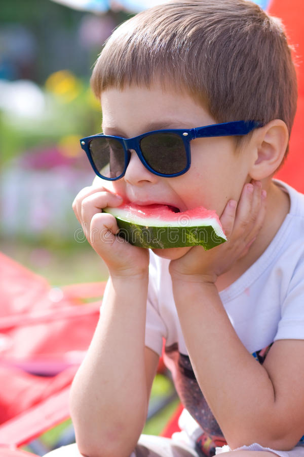 Boy eating watermelon in summer royalty free stock photo