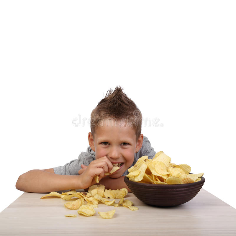 Boy eats chips royalty free stock photos