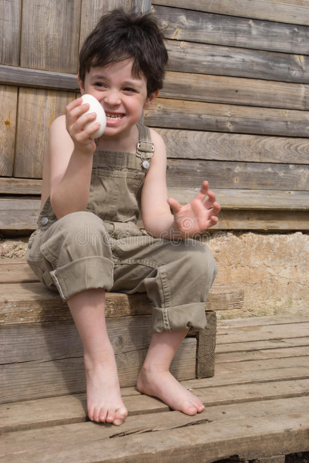 Download The boy with egg stock photo. Image of eyes, capsule, mischief - 9982724