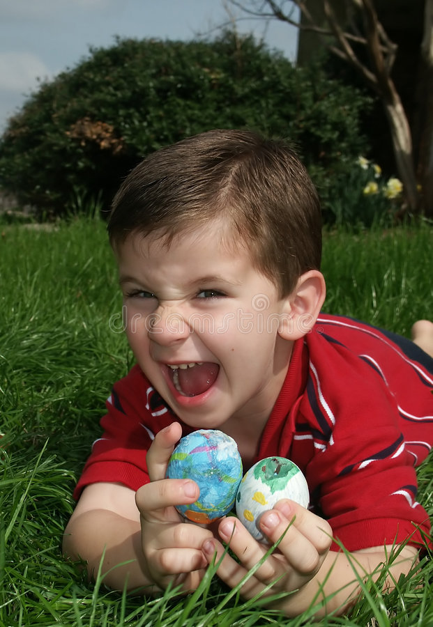 Boy with eggs 12. A young boy very excited about finding Easter eggs stock images