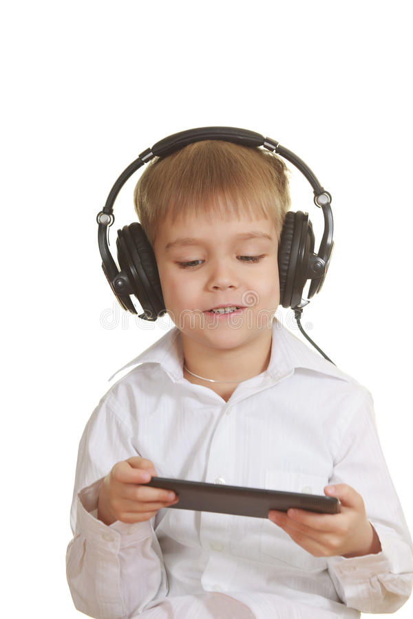 Boy with electronic pad and phones stock images