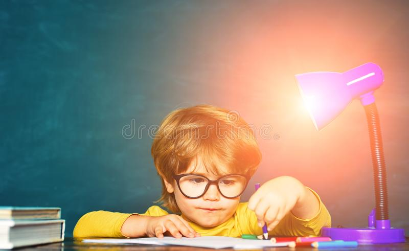 Boy from elementary school at the school yard. Cheerful child at the blackboard. Science education concept. royalty free stock photos