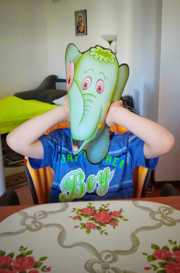 Boy with elephant mask stock image
