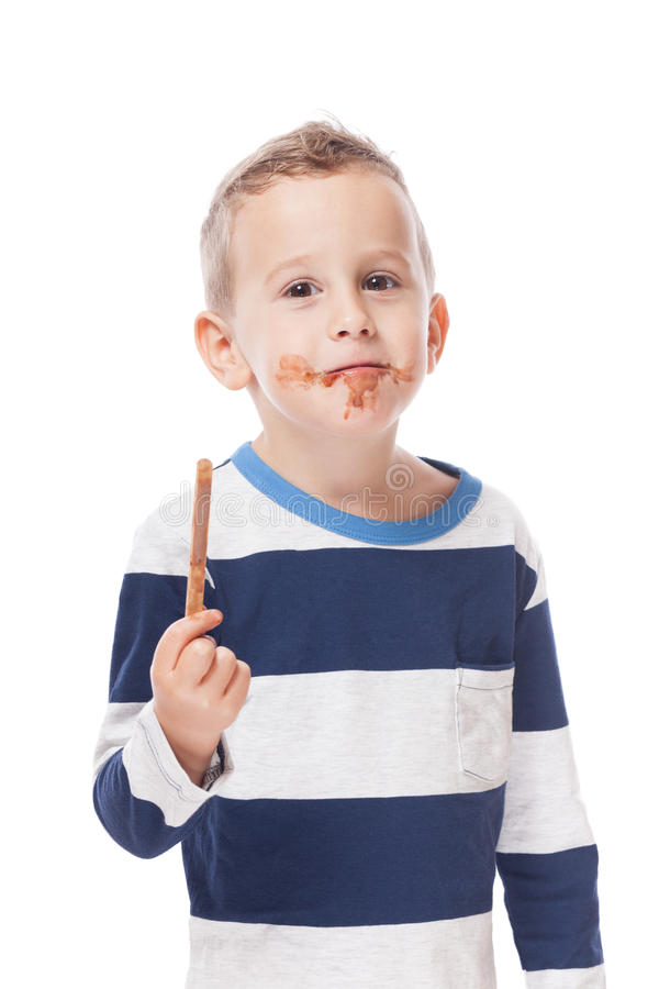 Boy with empty ice-cream stick. Funny boy with empty ice-cream stick on isolated white royalty free stock photos