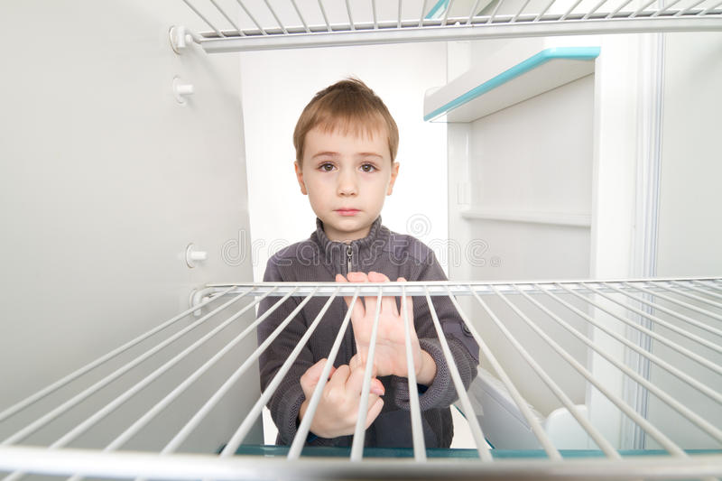 Download Boy And Empty Refrigerator Royalty Free Stock Photo - Image: 18362465