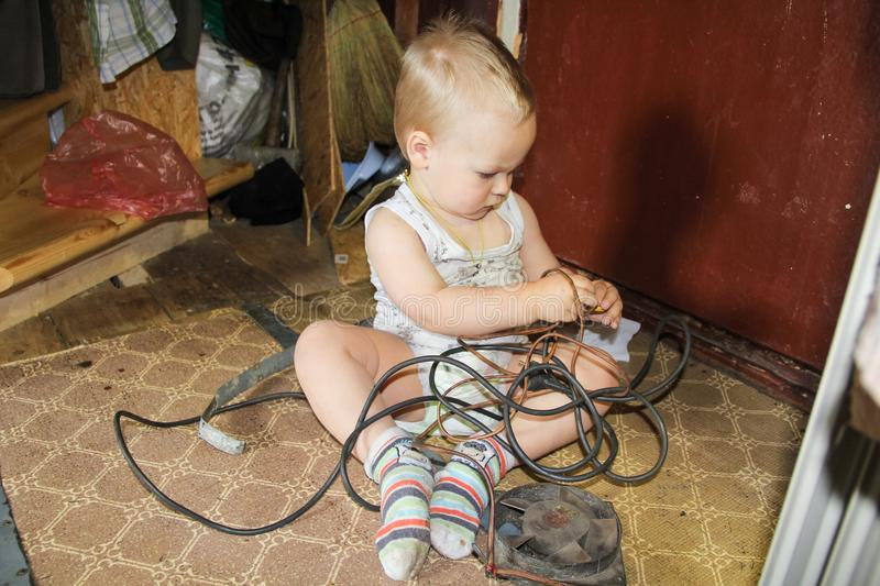 The boy is engaged in repair. stock photo