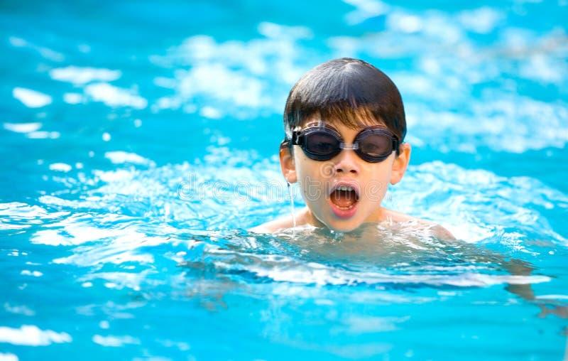 Boy enjoying a good swim in the pool. Young boy enjoying a good swim in the pool royalty free stock photography