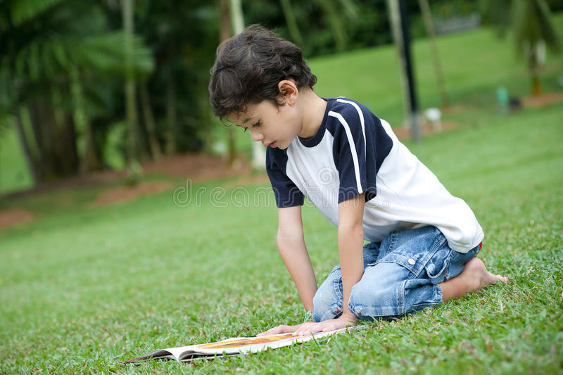 Download Boy Enjoying His Reading Book In Outdoor Park Stock Image - Image of practice, notebook: 14905525