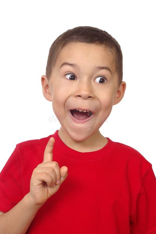 Boy exclaiming ah-ha stock photos