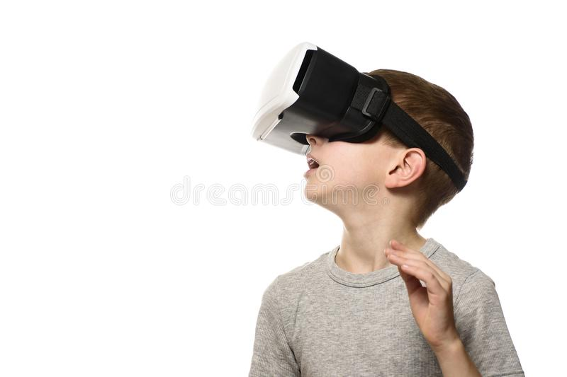 Boy experiencing virtual reality. Portrait. Isolate on white background. Side view. Technology concept.  royalty free stock image