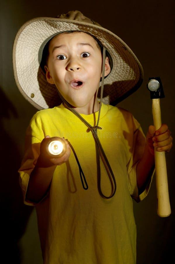Boy exploring with flashlight stock photos